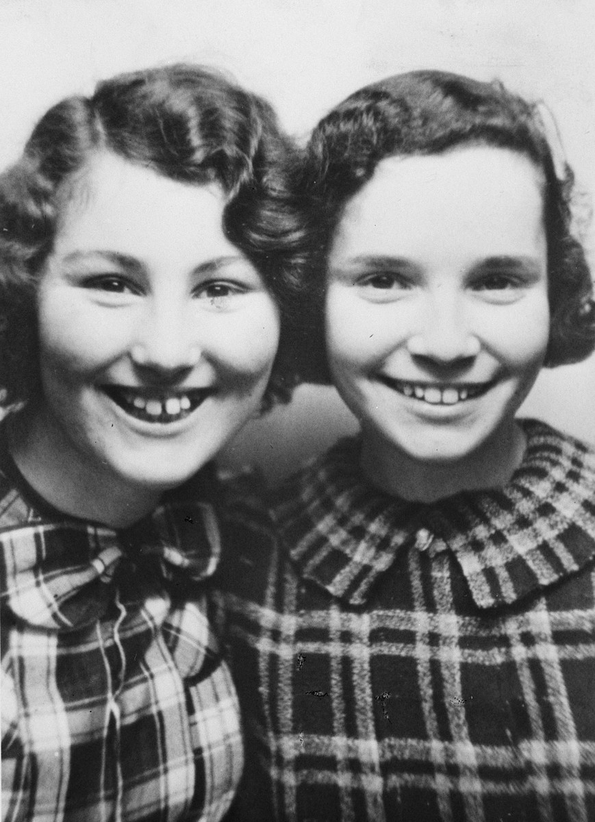 Close-up portrait of two Jewish school girls in Berlin.  Pictured are Ursula Totschek and her friend Helga.