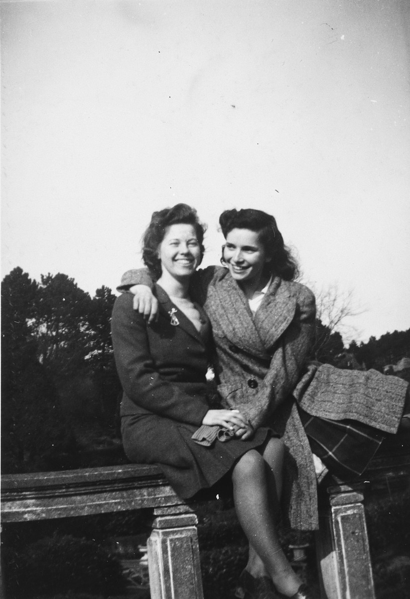 A German-Jewish teenage girl poses next to her friend while in England on a Kindertransport.  Pictured are Ursula Totschek (right) and her friend Jean Prodham.