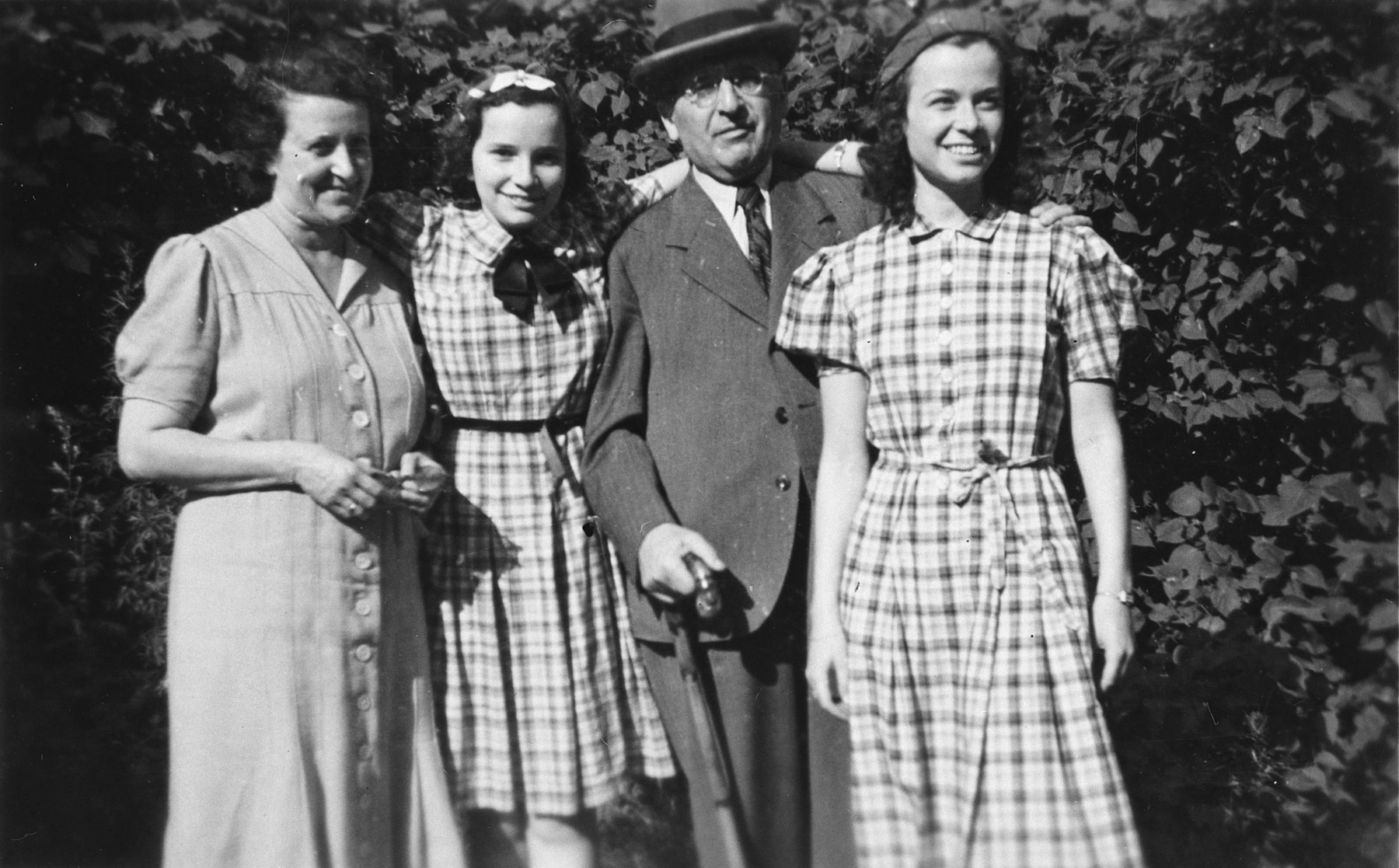 Portrait of a German-Jewish family taken shortly before their younger daughter left on a Kindertransport for England.  From left to right are Bianca, Ursula, Walter and Gertie Totschek.