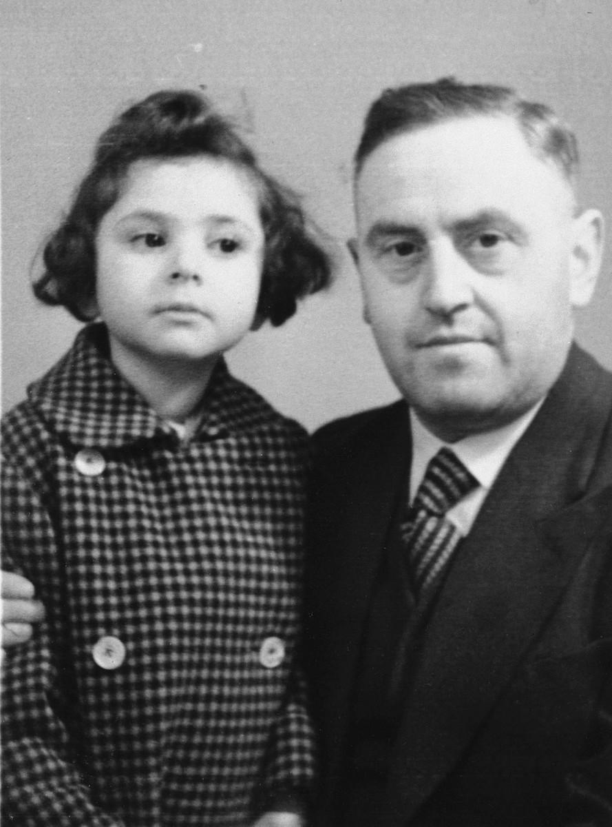 AnneMarie Feller poses with her father Hermann Feller before fleeing to Belgium.