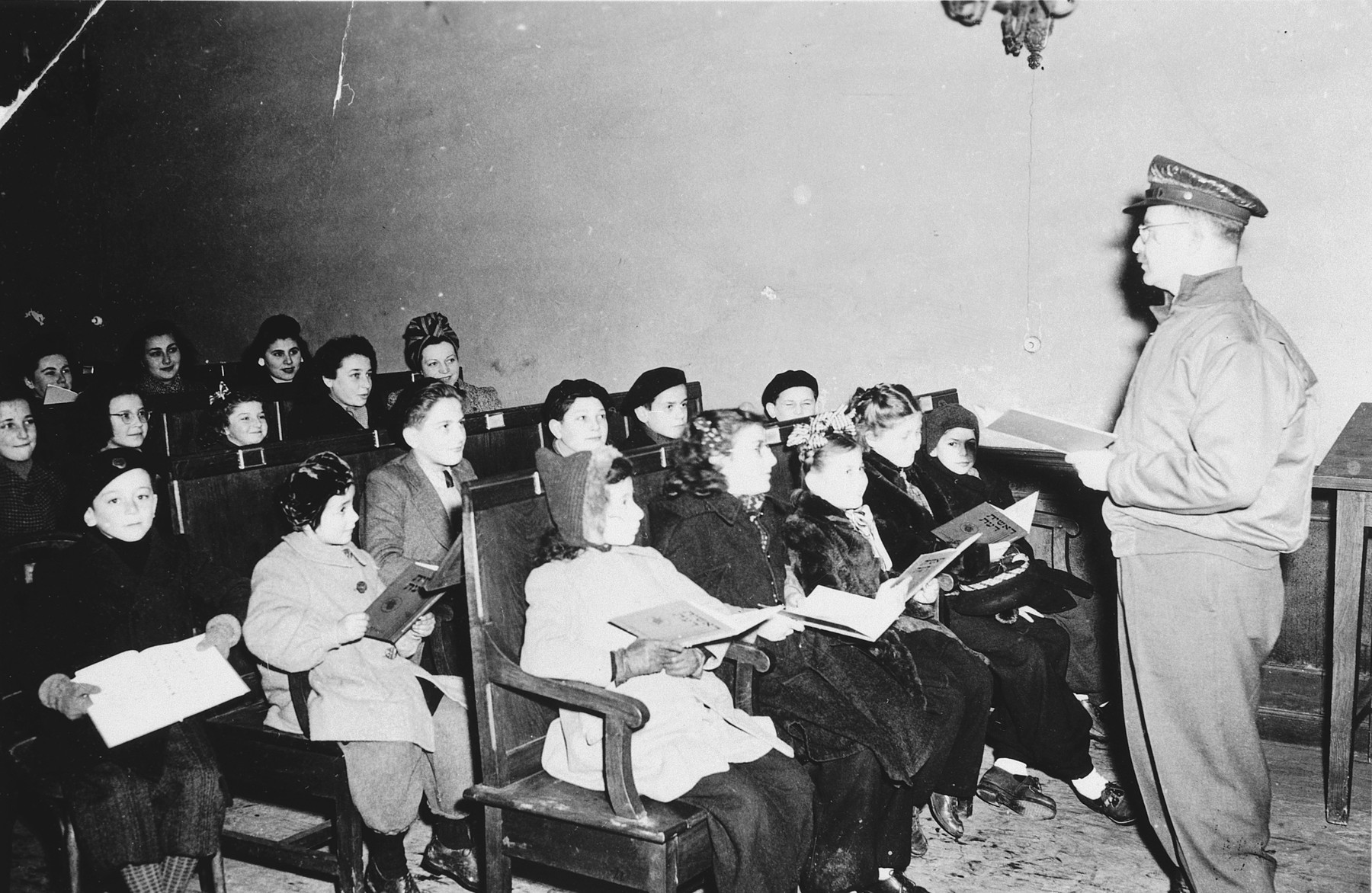 American Army chaplain Klein provides religious instruction to French Jewish children after liberation.