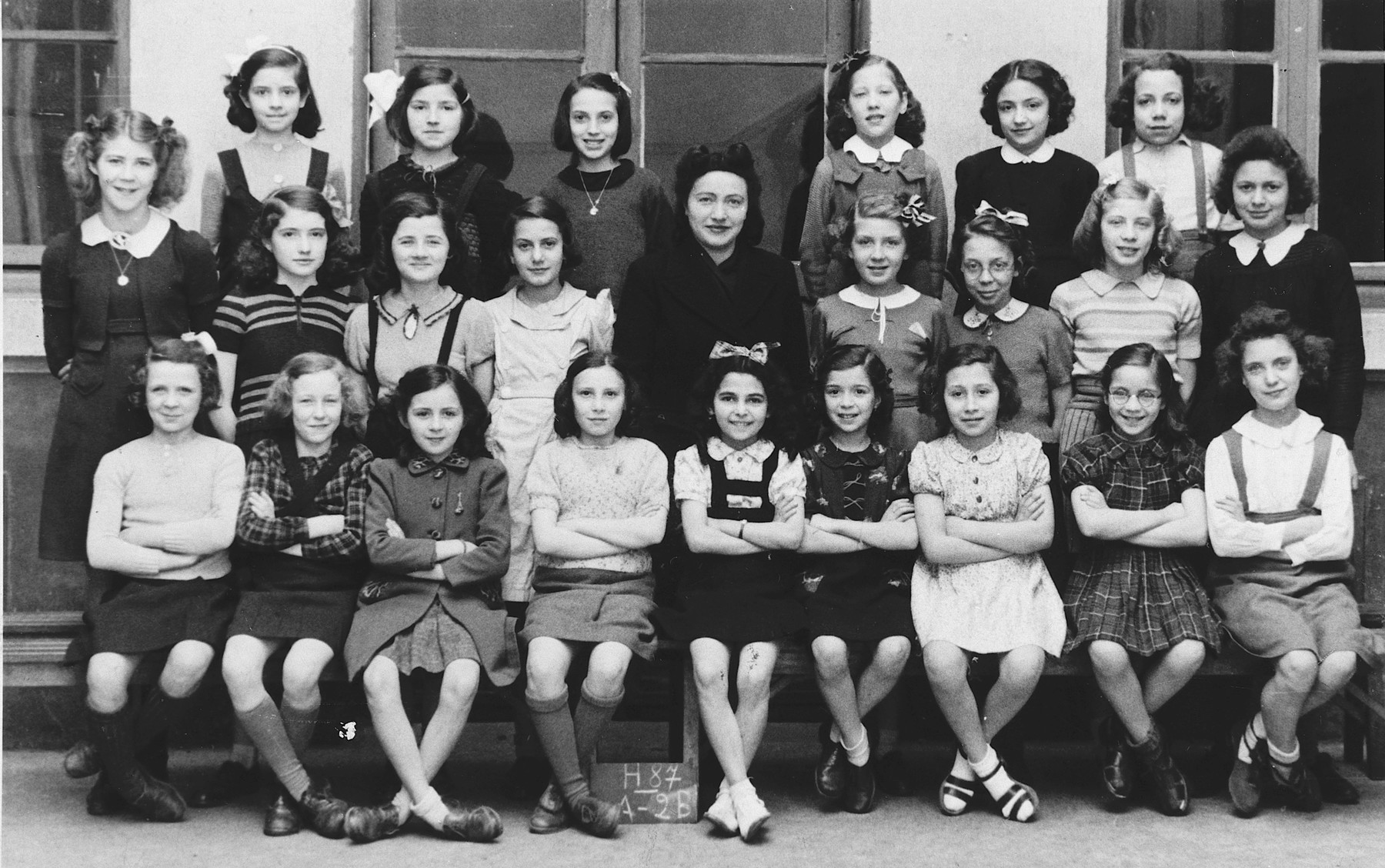 Class portrait of girls in a French elementary school.  Pictured in the front row (fifth from the left) is the only Jew in the class, Regine Gartenlaub.