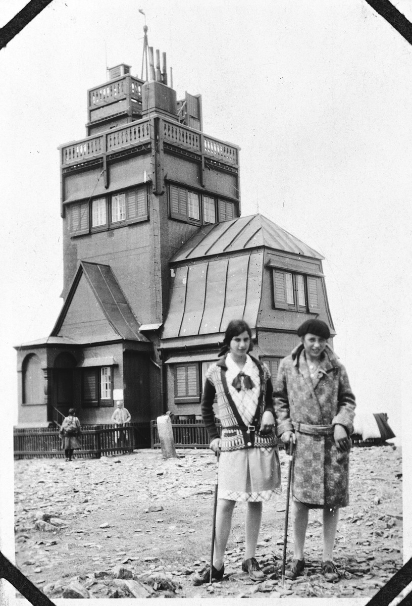 Hildegard Wolff (left) poses with a friend in front of a weather station on the top of the Schneekoppe.