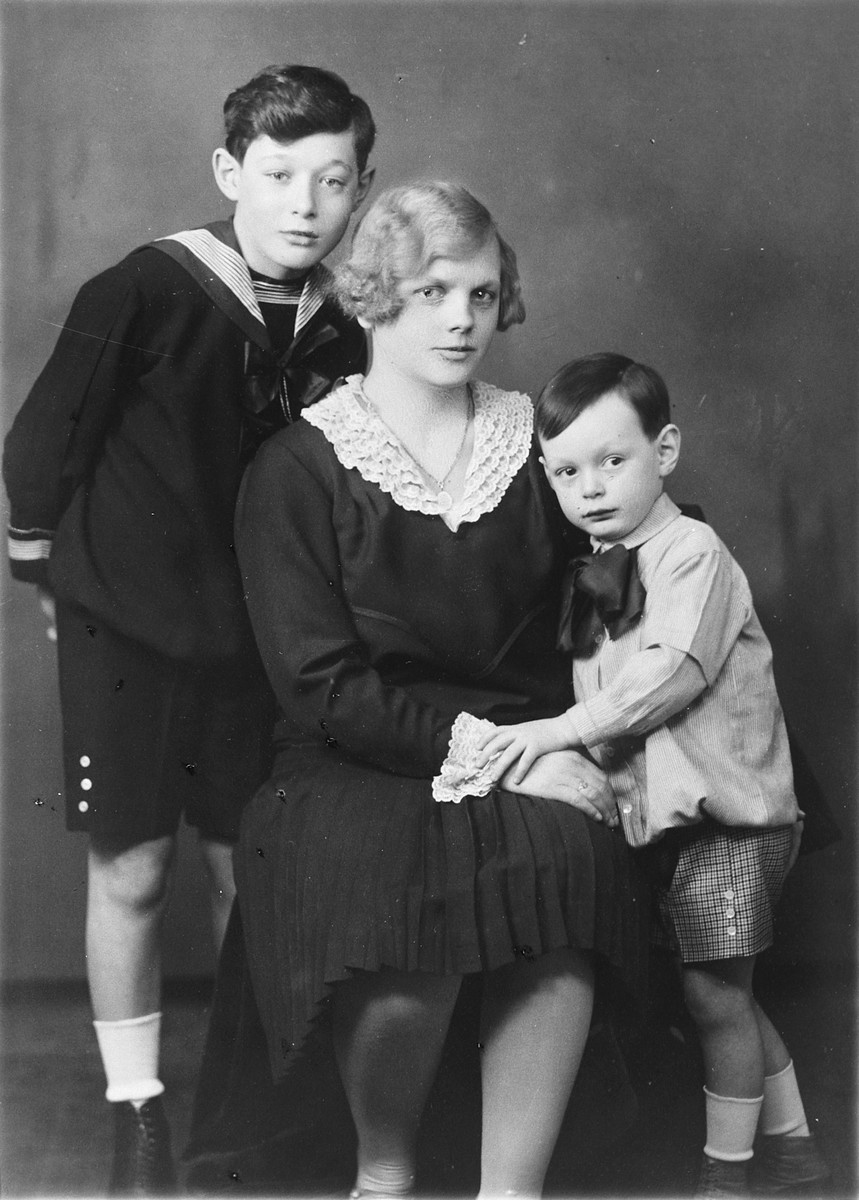 Studio portrait of two Hungarian-Jewish boys and their Hungarian nanny.  Pictured from left to right are Paul Fisch, Anna Tatrai and Robert Fisch.  Anna Tatrai later rescued the boys' mother and was recognized as Righteous Among the Nations.