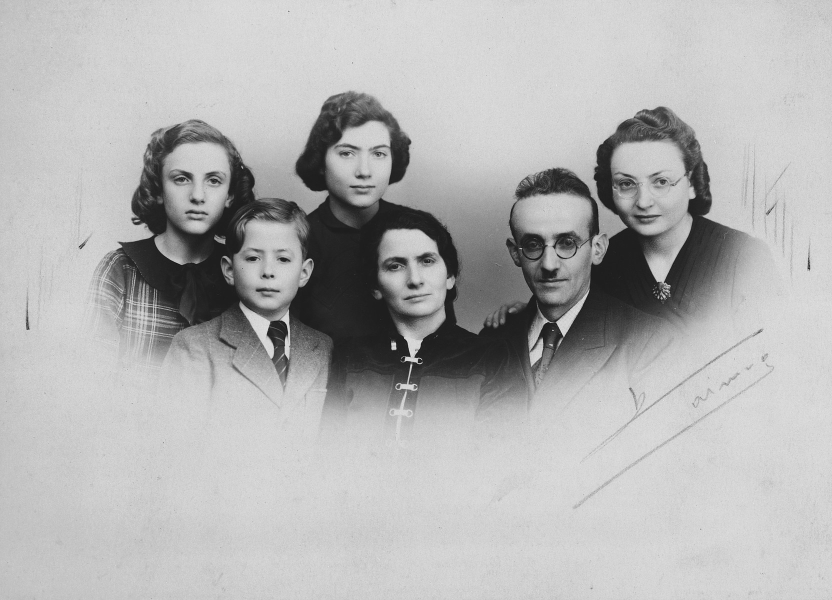Wartime portrait of a French-Jewish family.  From left to right are Suzanne, Henri, Rosette, Gittle, Shimon and Sarah Rivka Bomblat.