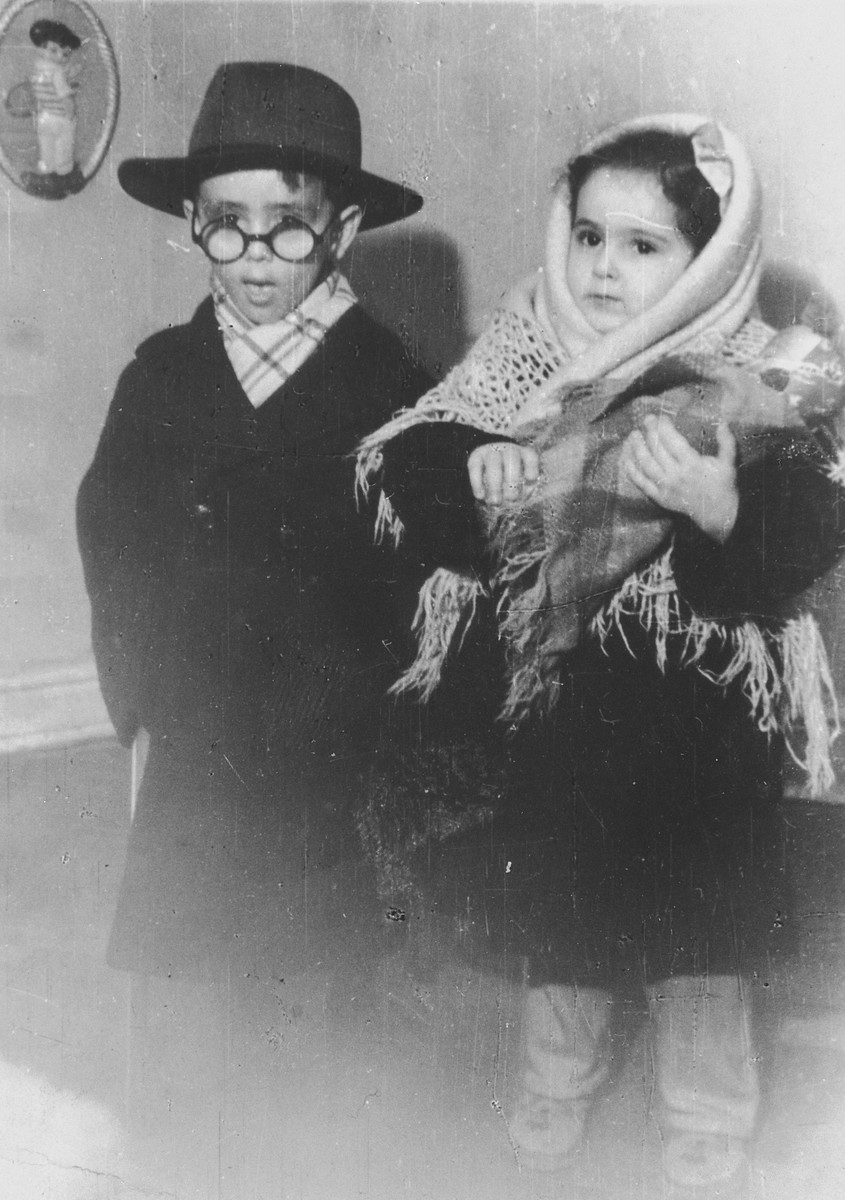 Close up portrait of a boy and girl in dress-up winter clothes in the Jewish kindergarten in Lodz.