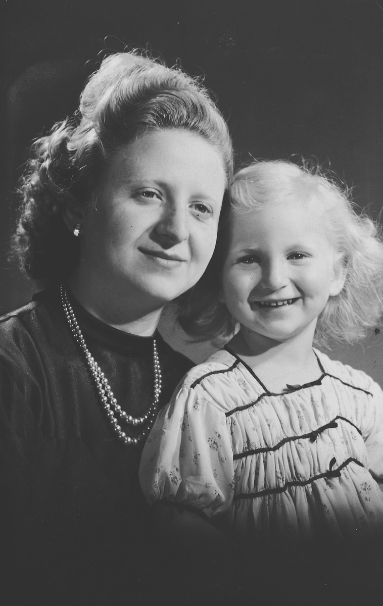 Studio portrait of a Belgian-Jewish mother and daughter taken shortly before they were forced to go into hiding.  Pictured are Fajga and Josiane Aizenberg.