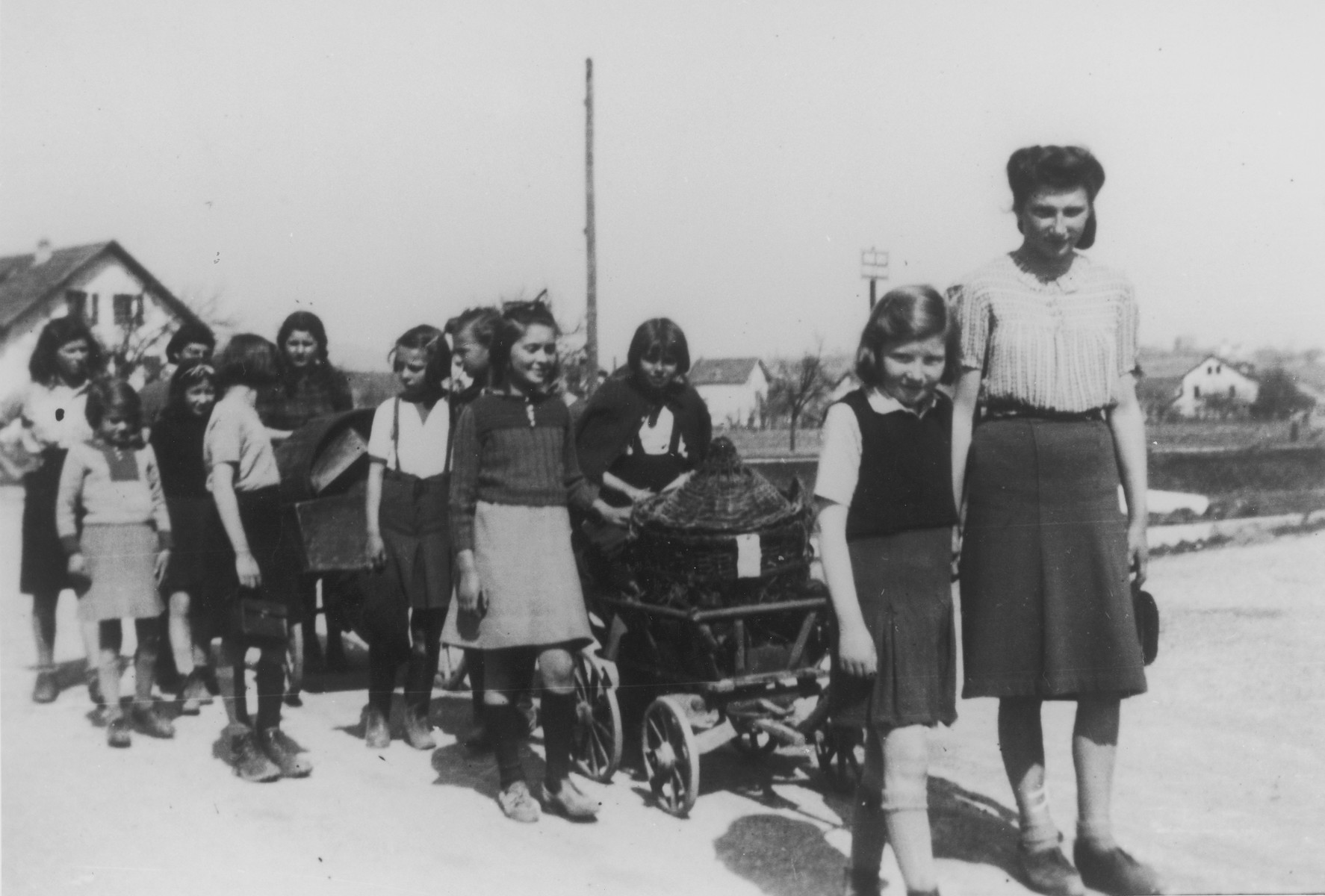 Hilda Krieser takes a group of children for a walk in the Rivesaltes transit camp.