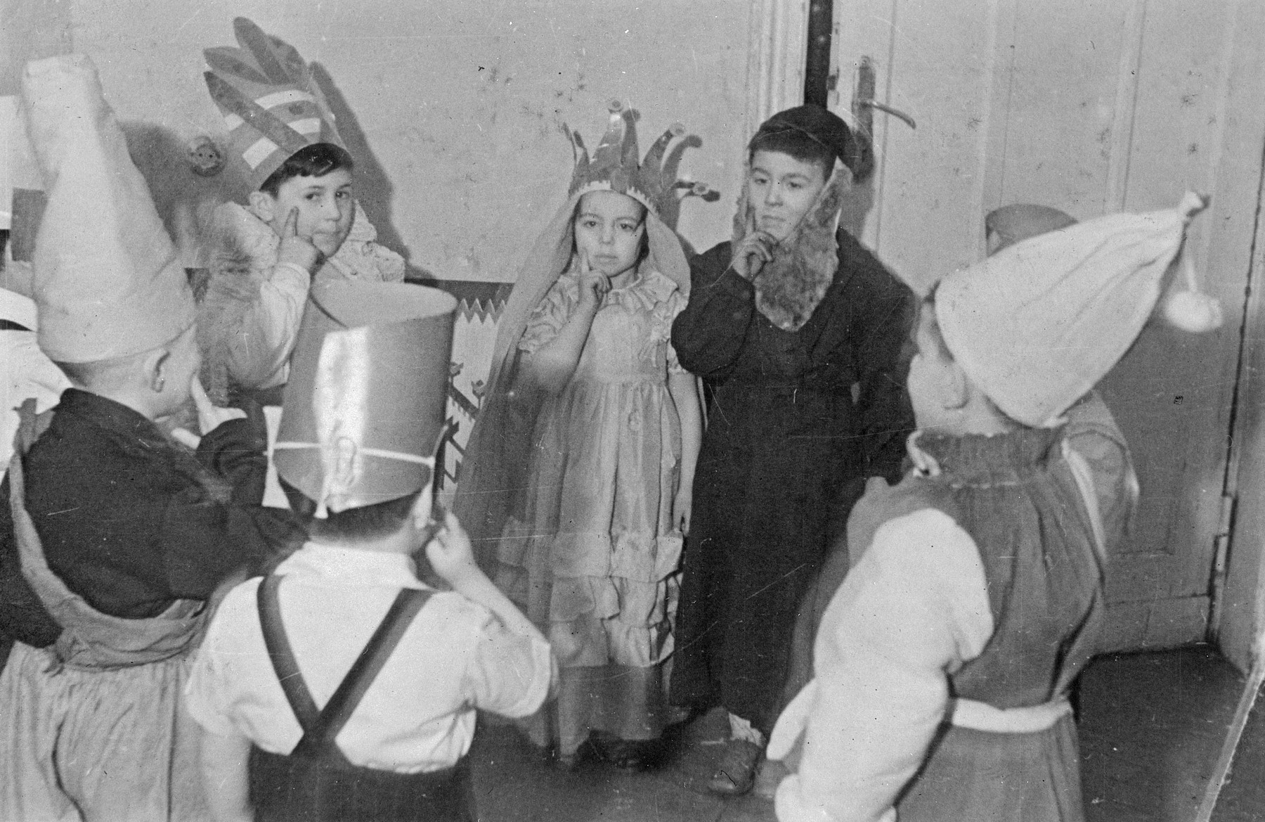 Children dressed in costumes from the Lodz Jewish kindergarten perform what is probably a Purim play.