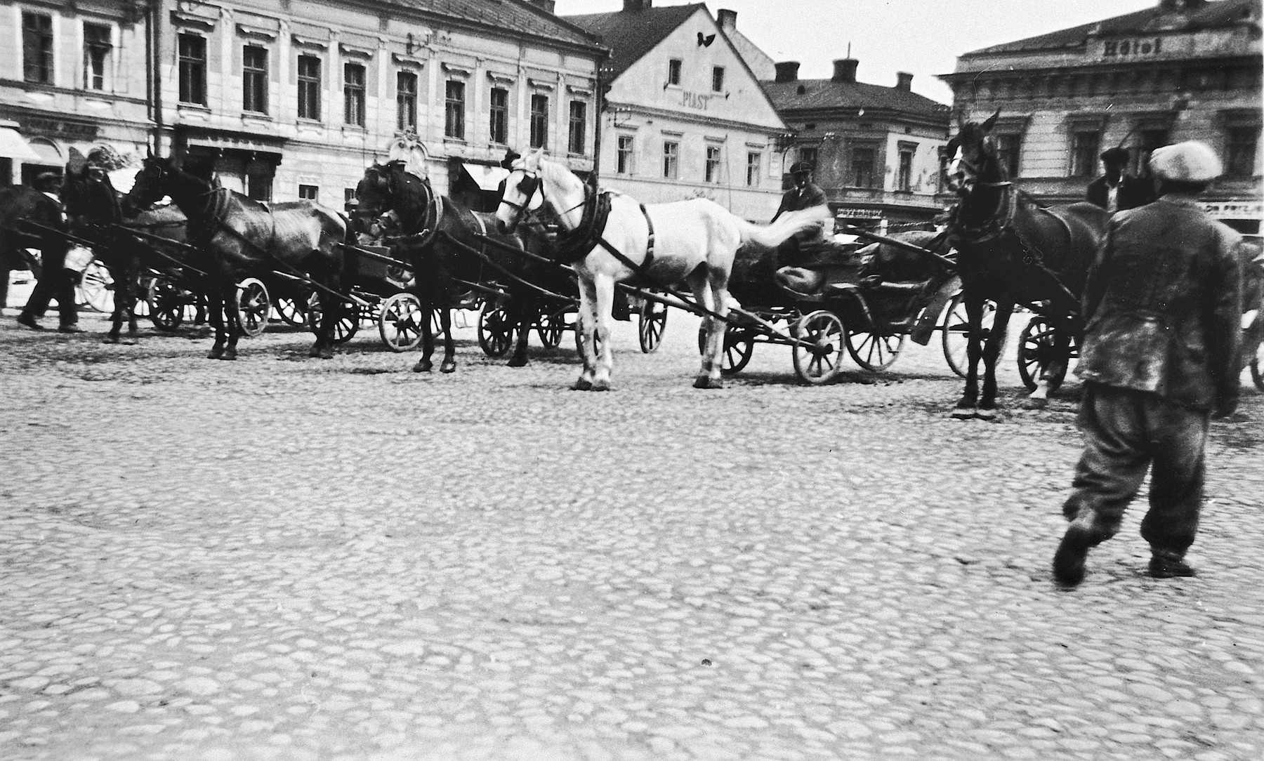 Horse-drawn carts line up in of the public square that served as an outdoor market in Oswiecim, Poland [later Auschwitz] before the war.