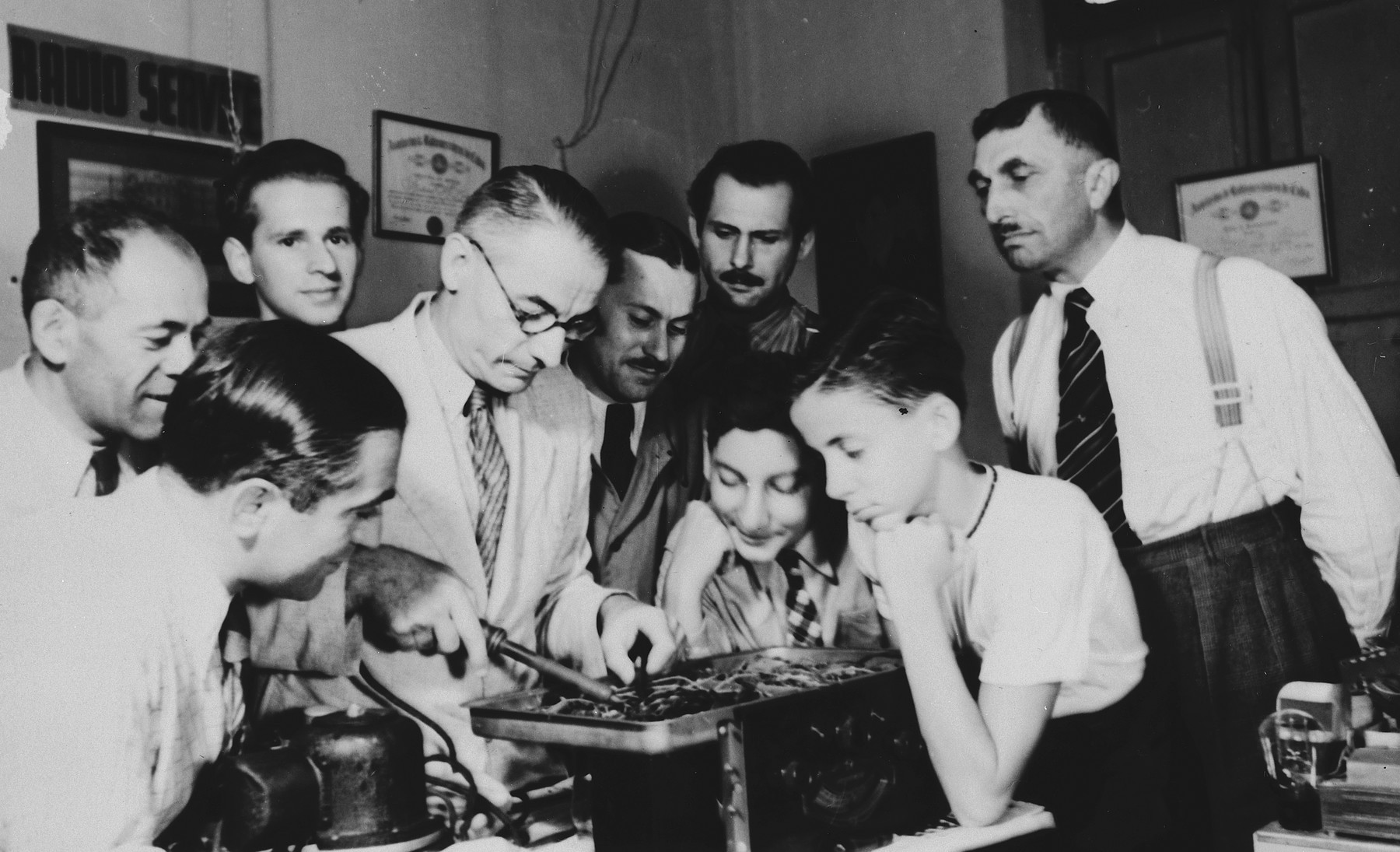German-Jewish refugees study radio repair in a vocational education class in Cuba.  Among those pictured is Henry Fink, uncle of the donor.