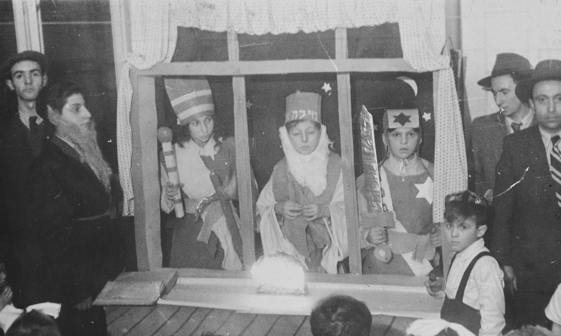 Jewish children perform a Hanukkah play in the Jewish school in Lodz after the war.