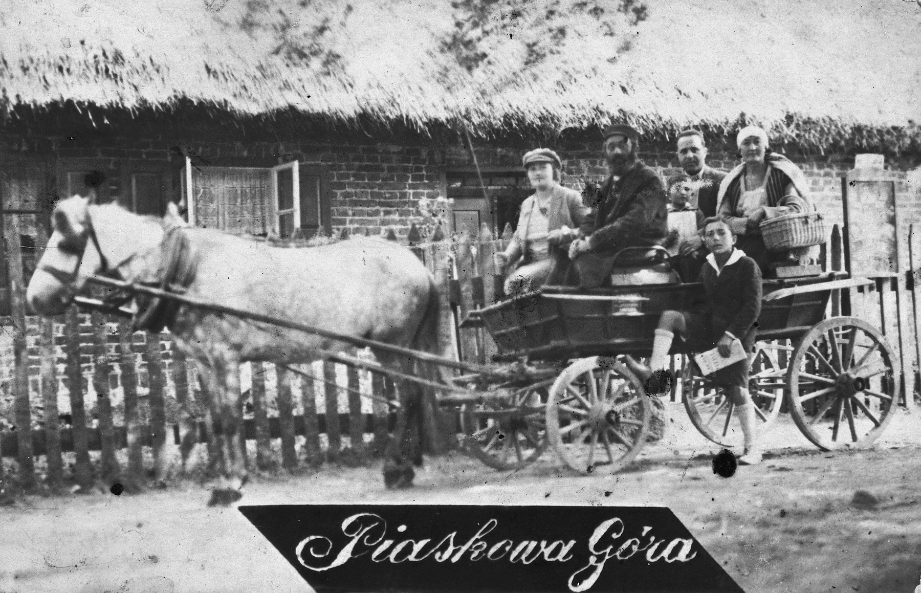 The Friedman family takes a horse and cart ride while on vacation in Piashkowa Gora.  Izaac is pictured standing alongside the cart.