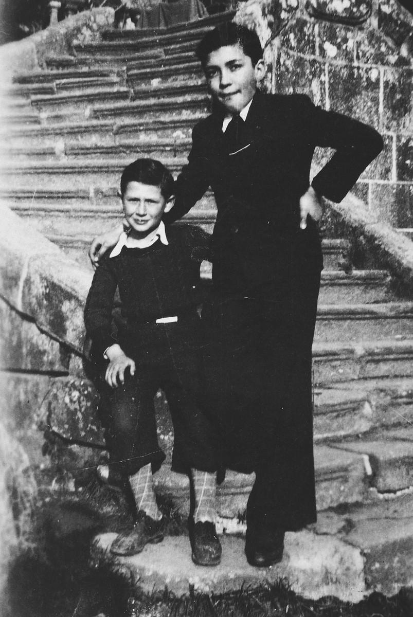 Close-up portrait of two Jewish boys standing outside the front steps of the Masgelier children's home in France.  Pictured are Israel Lichtenstein (left) and a friend.