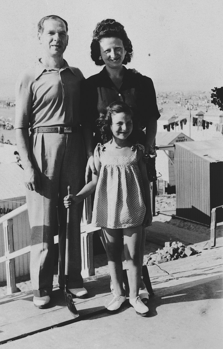 A Belgian-Jewish family poses on the terrace of a building after being reunited after the war.  Pictured are Jacques, Fajga, and Josiane Aizenberg (in front).