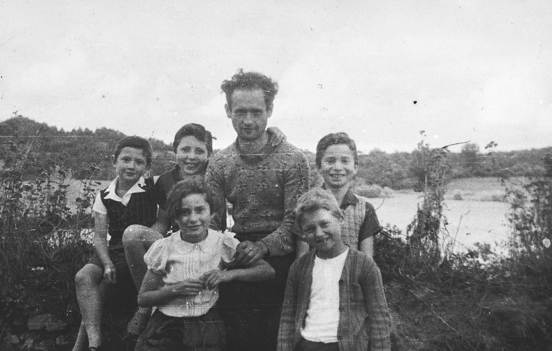 Group portrait of five children and a man ouside the Masgelier children's home in France.  Among those pictured is Israel Lichtenstein (second row, right).