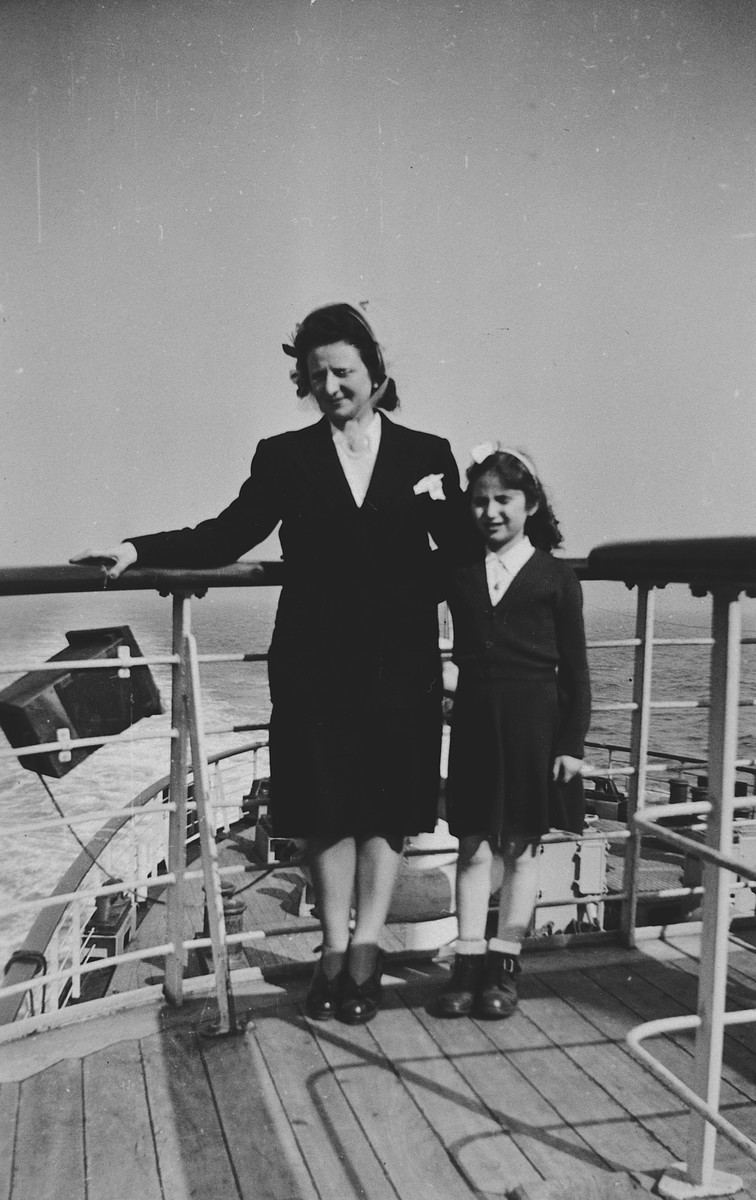 A mother and daughter pose on the top deck of a ship [while on route to the United States].  Pictured are Fajga and Josiane Aizenberg.