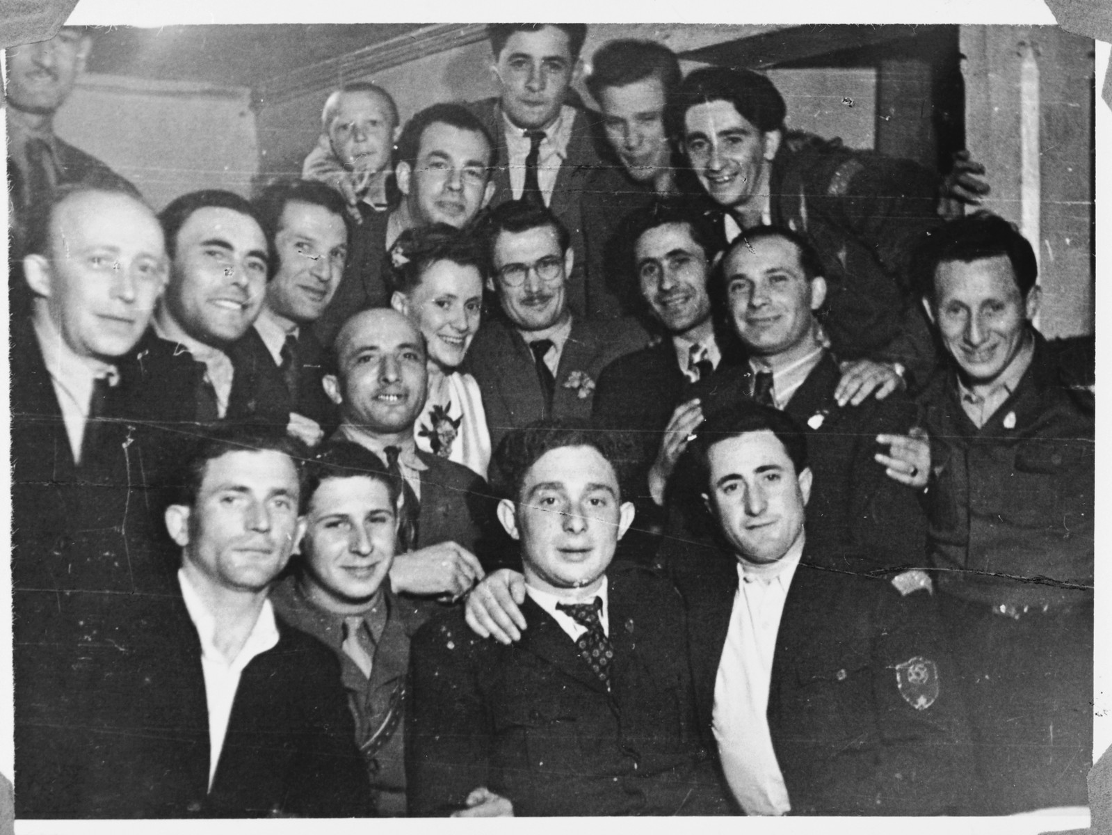 Relief workers, Marion and Tony Pritchard (center), celebrate their wedding in the Windsheim displaced persons' camp.  Also pictured is Abraham Adler (front, center).