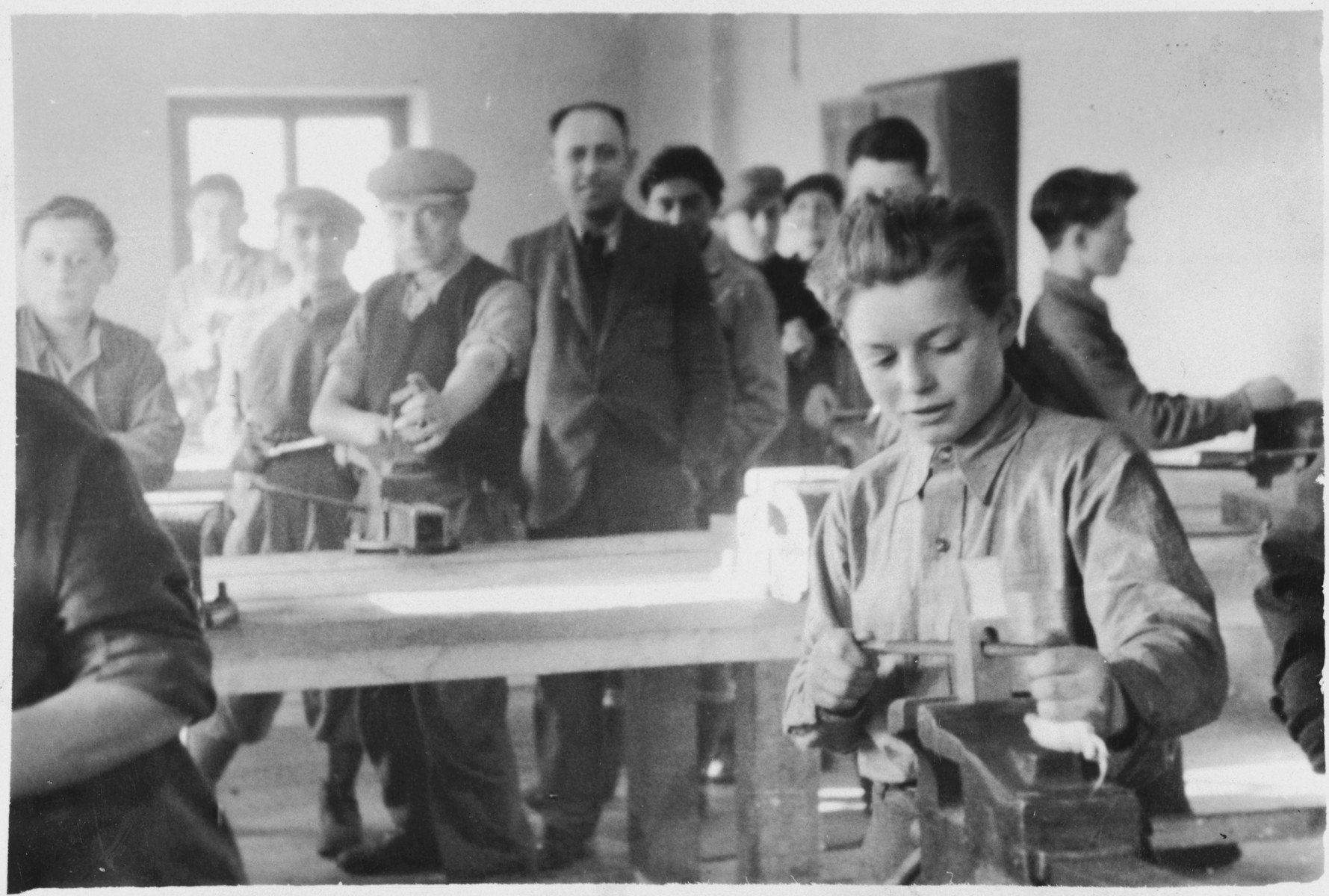 Jewish men and youth practice carpentry in a vocational workshop (probably in the Foehrenwald displaced persons camp).