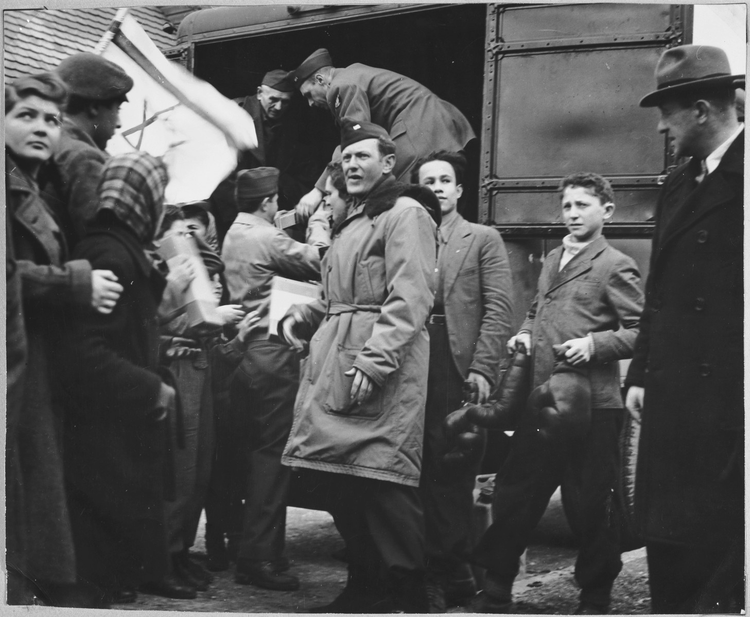 Relief workers in the Foehrenwald displaced persons' camp unload supplies from a truck.