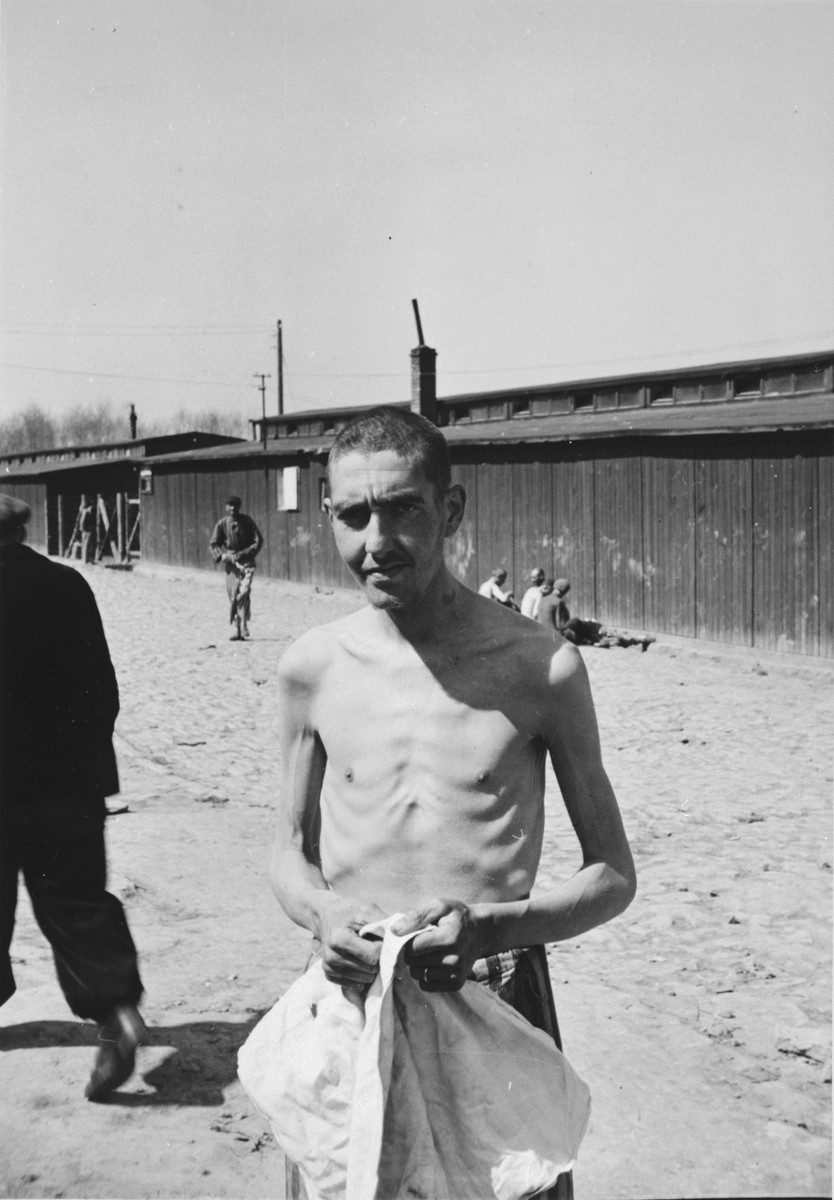 An emaciated Russian survivor stares into the camera after his liberation at Buchenwald.