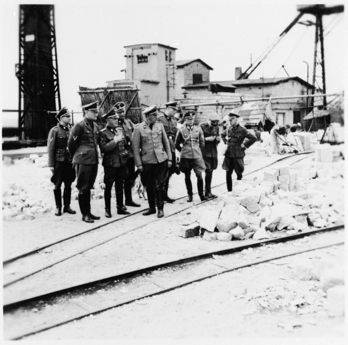 SS-Obergruppenfuehrer Schmauser visits the quarry in the Gross-Rosen concentration camp.  Accompanying him is the commandant, Arthur Roedl.