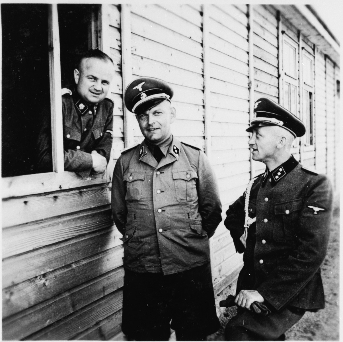 Close-up portrait of three SS officers in Gross-Rosen.  Pictured on the far right is the adjutant Kuno Schramm.