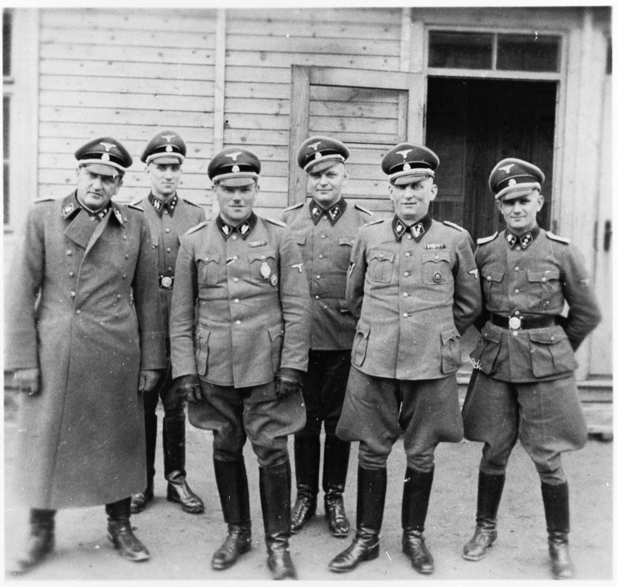 SS Oberfuhrer Hans Loritz, commandant of Sachsenhausen (center) visits the Gross Rosen concentration camp.  Also pictured are Arthur Roedl (left), Friedrich Entress (second from the left) Hans Loritz, Michl, Hubert Lauer (the administratie head of Sachsenhausen, second from right) and Anton Thumann (far right).  This photo was probably taken shortly before Gross-Rosen became an independent concentration camp and ceased to be a sub-camp of Sachsenhausen.