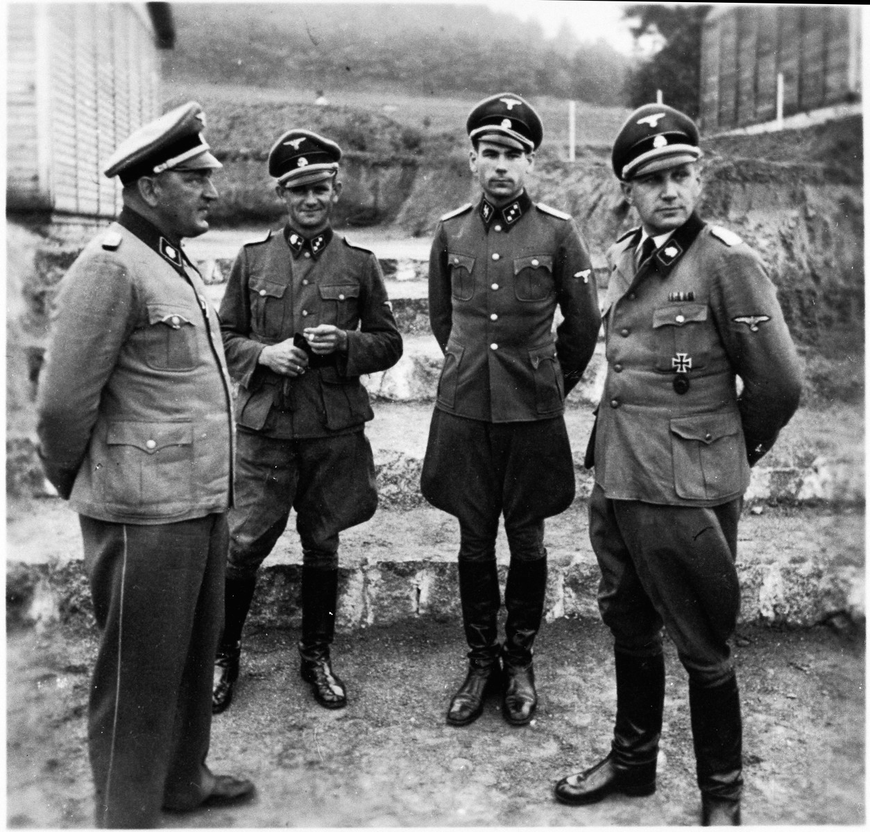 Group portait of four SS officers at the Gross-Rosen concentration camp.  Arthur Roedl is standing on the far let.  Next to him is Anton Thumann. An inscription on the back identifies one of the other two men as SS-Obersturmfuehrer Drosenhofer.