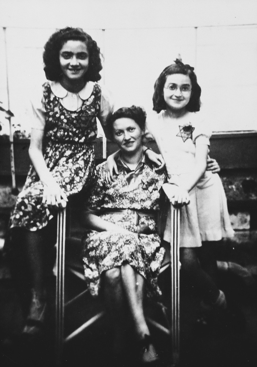 Portrait of a French-Jewish family wearing Jewish stars.  Pictured are Ruth, Fanny and Paulette Apfel.