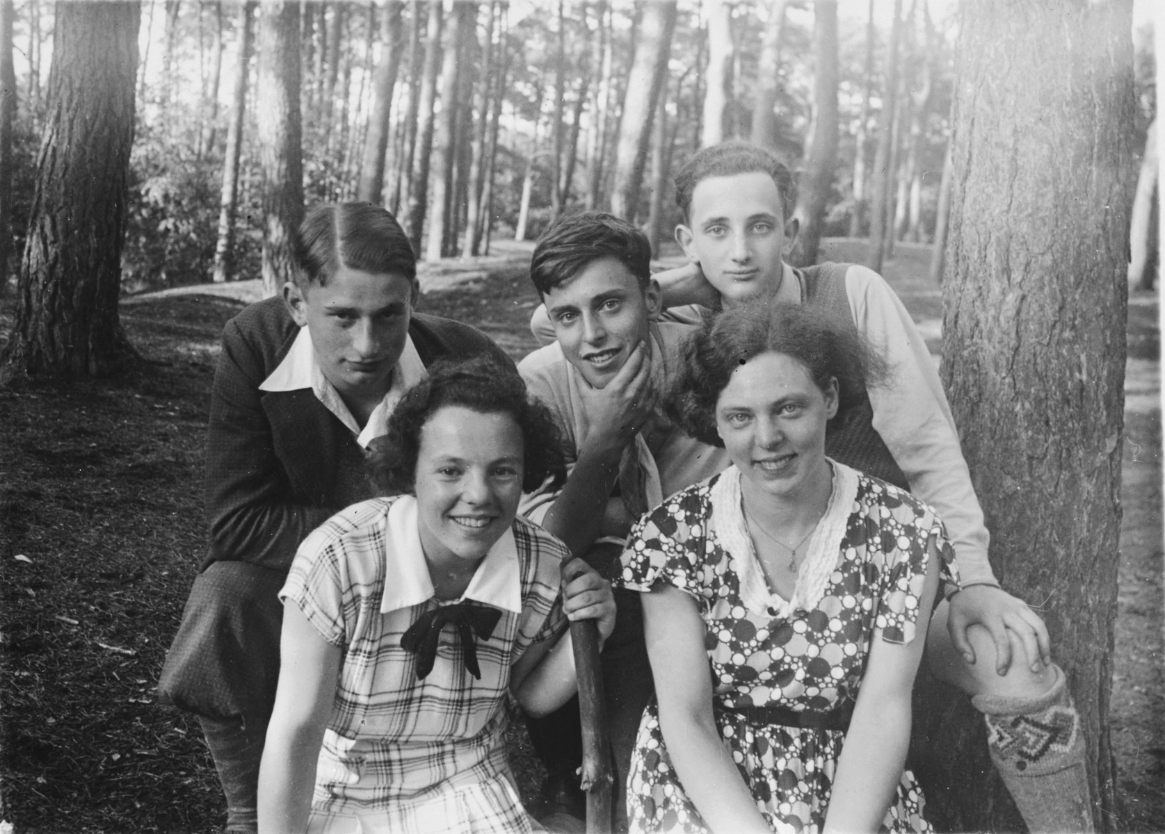 Group portrait of four Zionist youth.  Letty Rudelsheim is pictured on the bottom left.