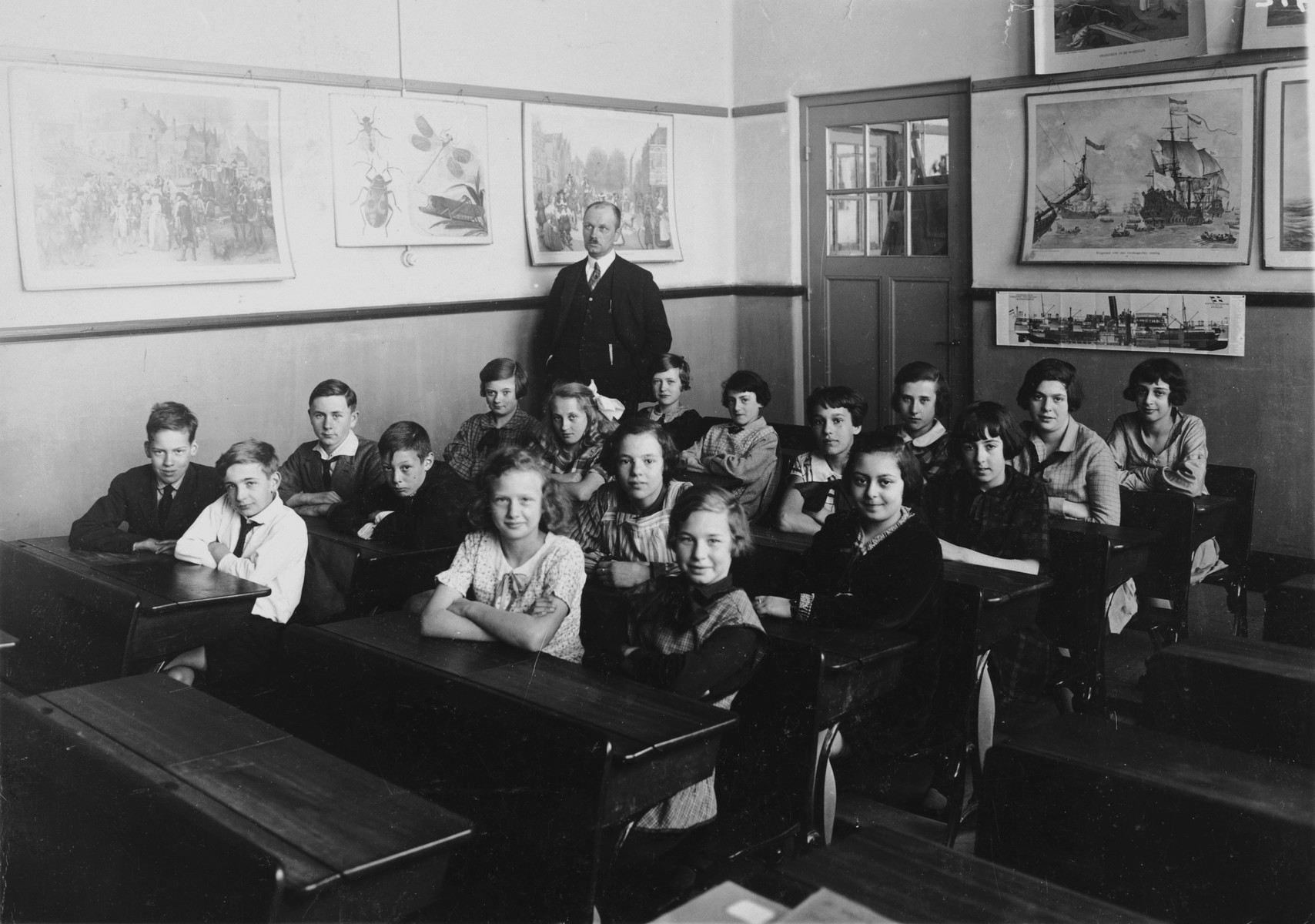 Group portrait of young children and teachers in a class in Amsterdam.
