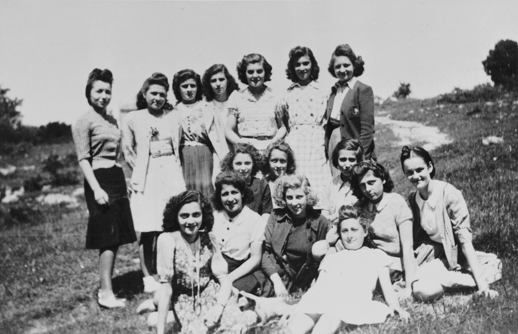 Group portrait of a girl's Latin class on an excursion.  Among those pictured is Ruth Apfel.