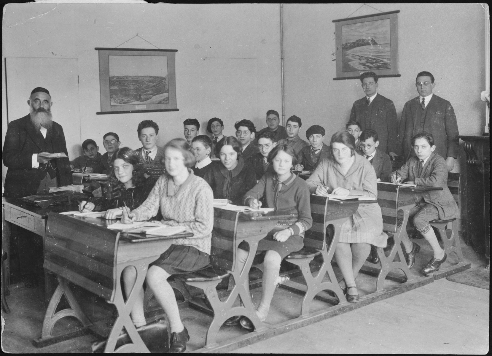 Group portrait of teenagers and teachers in a class of the Jewish high school in Amsterdam.  Letty Rudelsheim is pictured in the second row, second from the right.