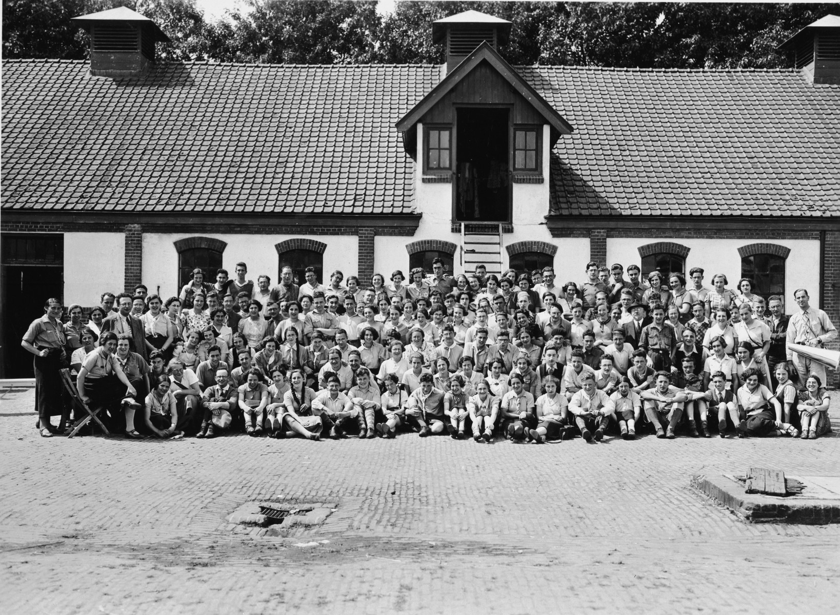 Group portrait of students in a Jewish school in Oosterbeek.  Among those pictured is a young teacher, Letty Rudelsheim.