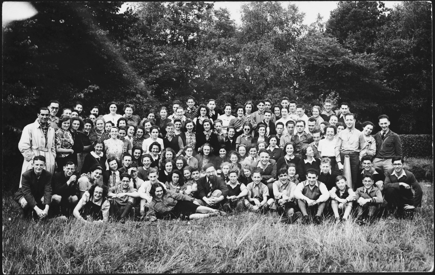 Group portrait of teenagers in a Mizrachi, religious Zionist summer camp in The Netherlands.  Letty Rudelsheim is pictured standing in the second row, fourth from the right.  Also pictured is Natan Dasberg (center).