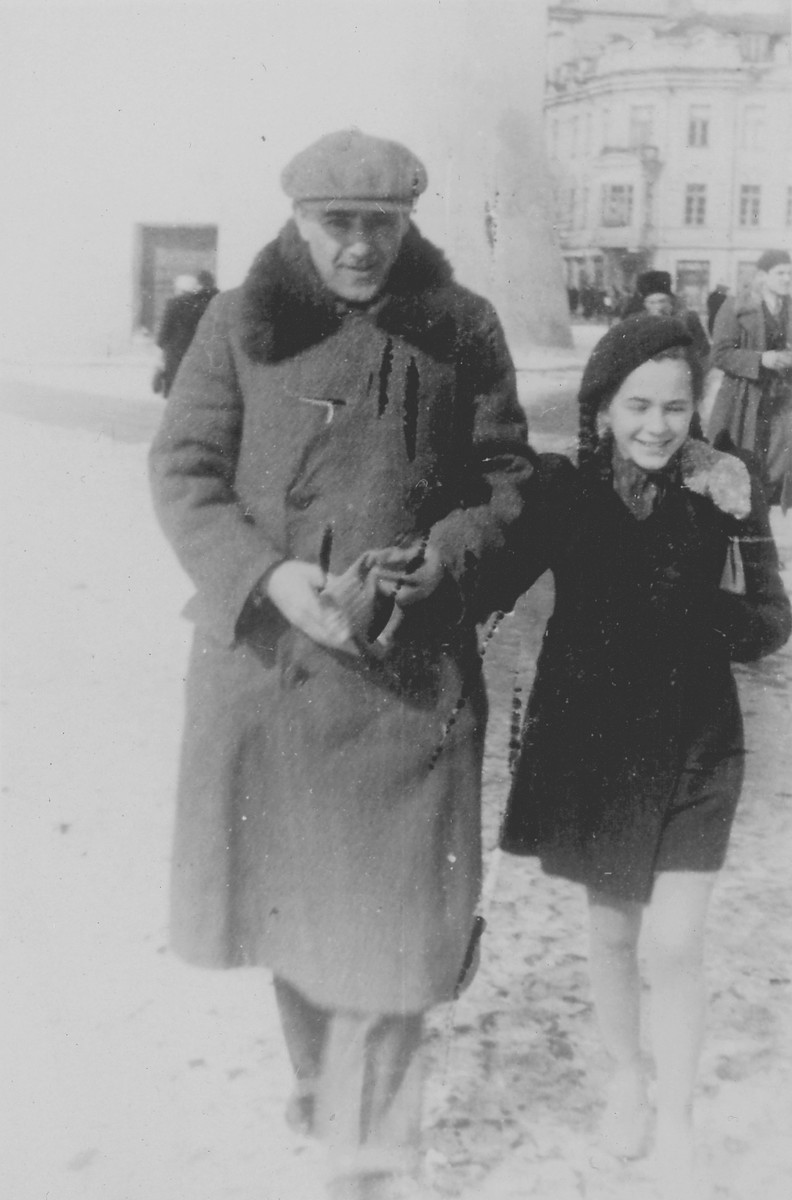 Jewish refugees on a street in Vilna.  Pictured are Tamara Dynenson and her uncle Aron Wecksler.