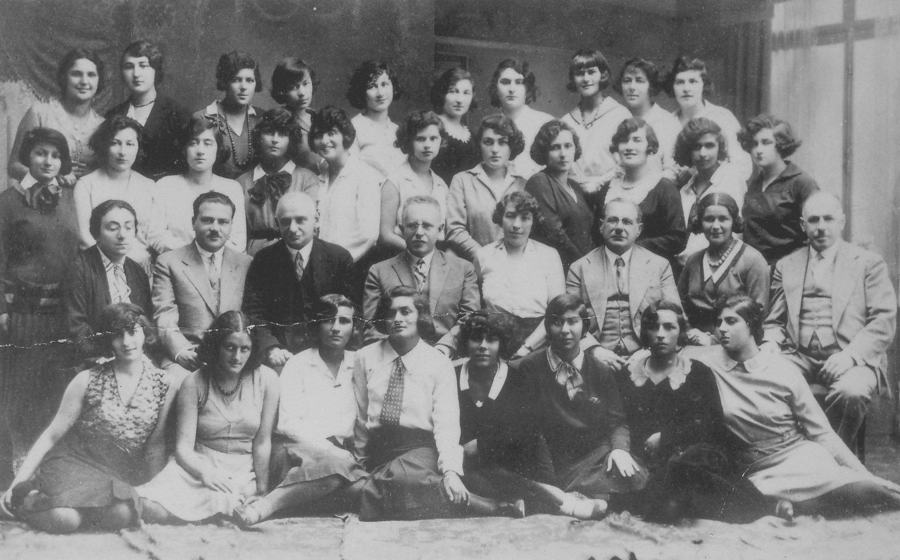 Teachers and students at Zofja Kalecka Gimazjum, a private Jewish girls high school in Warsaw.  The group pictured here is probably the graduating class of 1933.   The teachers seated in the second row are (left to right) Augusta Kalecka (Polish language and literature), A. Brandes (mathematics), Tadeusz Klimowicz (principal), Roza Baumgarten (German language and literature), Herman Kalecki (school owner), Stenia Majerowicz (physical education) and Michal Kalecki (school owner).