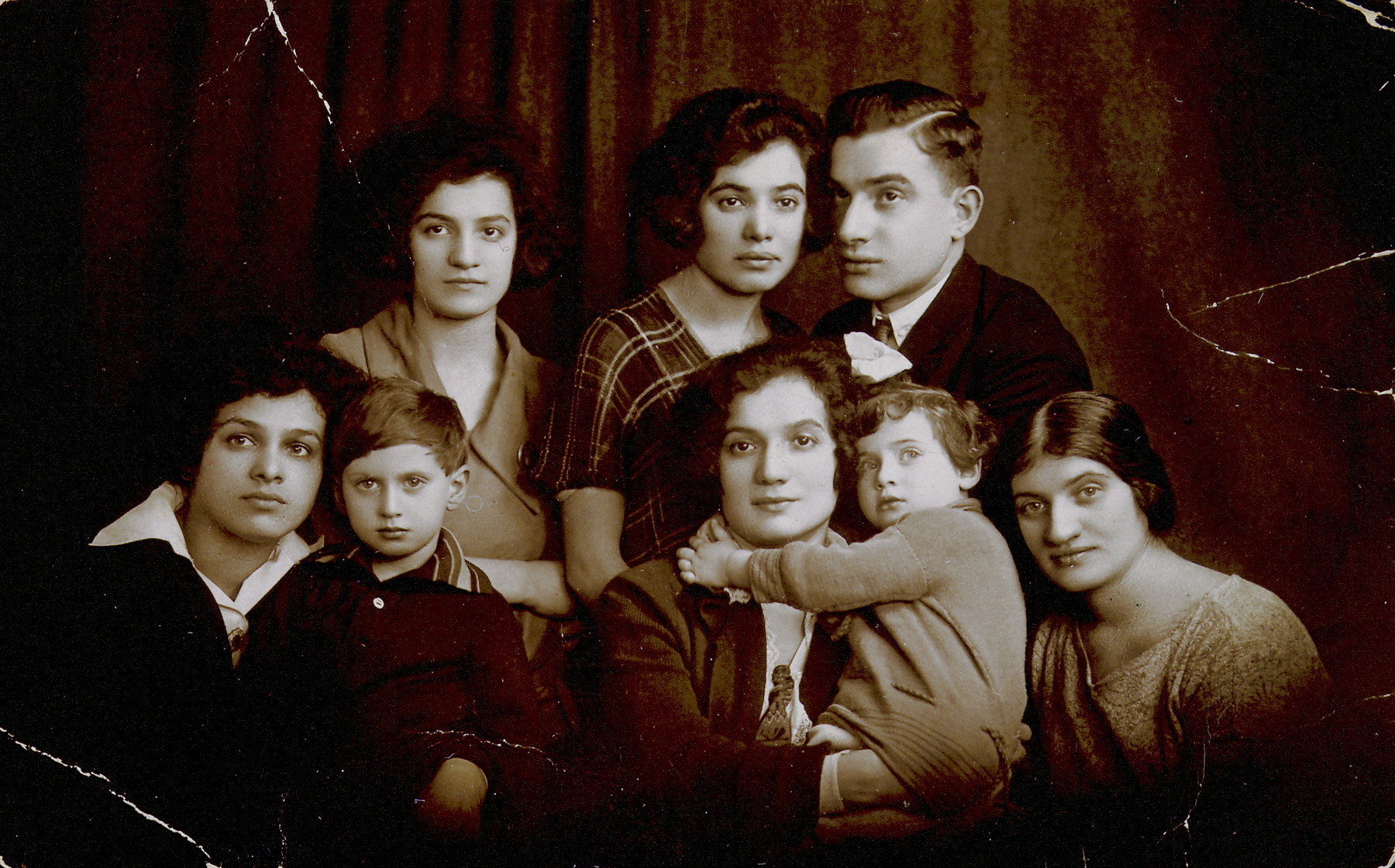Sonia Czemielinski Nowogrodzka with her siblings and their children on the occasion of her sister Anita leaving for America.  First row from right: Sonia Czemielinska Nowogrodzka, Cyla Czemielinska Jezior holding her daughter Basia, Markus Nowogrodzki, Chaja Czemielinska.  Second row from right: Nissan Czemielinski, Anita Czemielinska, and Esther Czemielinska.