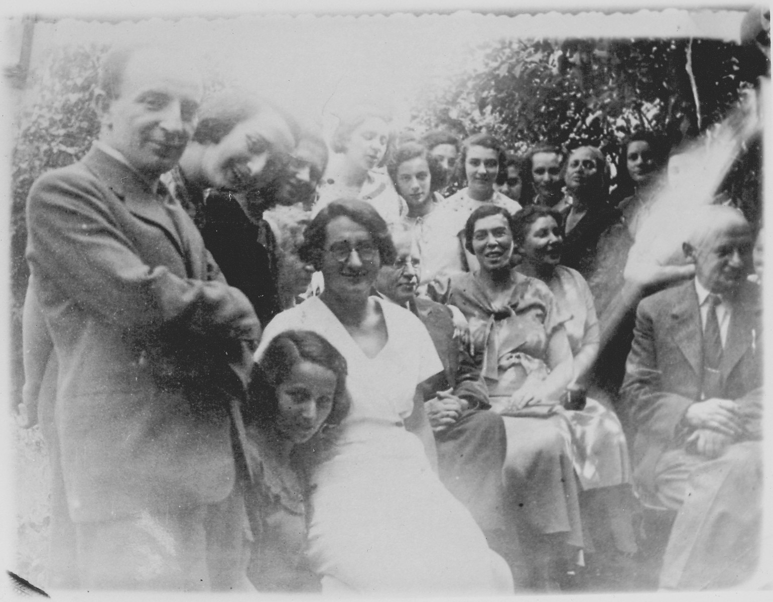 Teachers and students at Zofja Kalecka Gimazjum, a private Jewish girls high school in Warsaw.  The teachers in the photo are Falik Hafner (Jewish history), Maya Halbersztat (physics), Tadeusz Klimowicz (principal), Stanislawa Majerowicz (Polish literature), Helena Aszkenazy Szefner (French language and literature) and A. Brandes (mathematics).