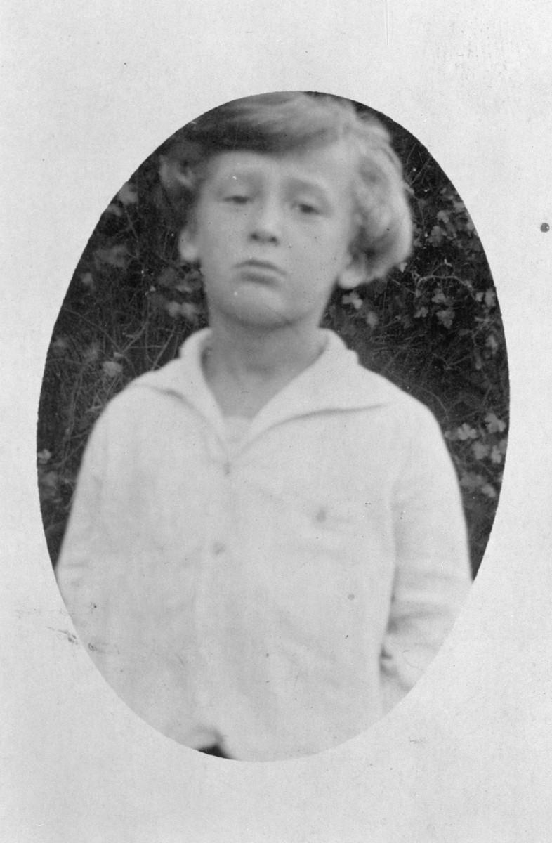 Close-up portrait of an Austrian Jewish boy.  Pictured is Karl Charles Stein.