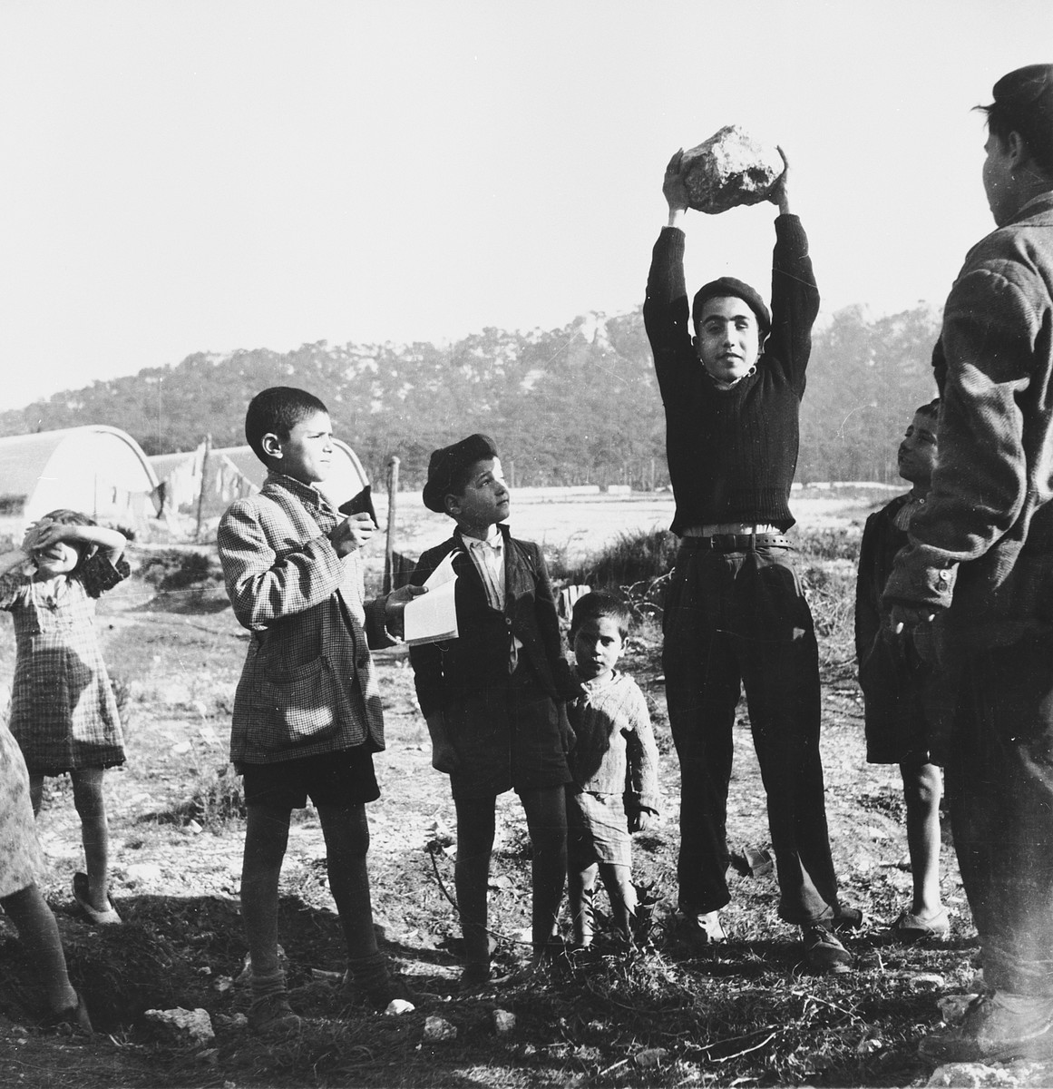 A group of Morrocan-Jewish boys gathers together in the Los Arenas camp while waiting to immigrate to Palestine.