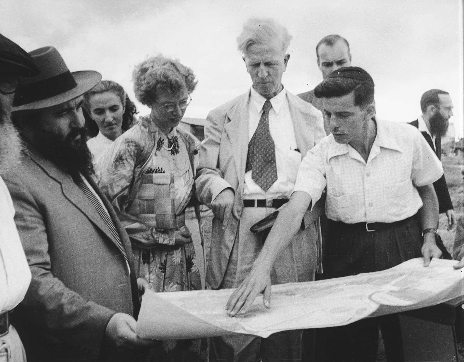 Ambassador James Grover McDonald and his daughter Barbara examine a building plan in a religious settlement in Israel.