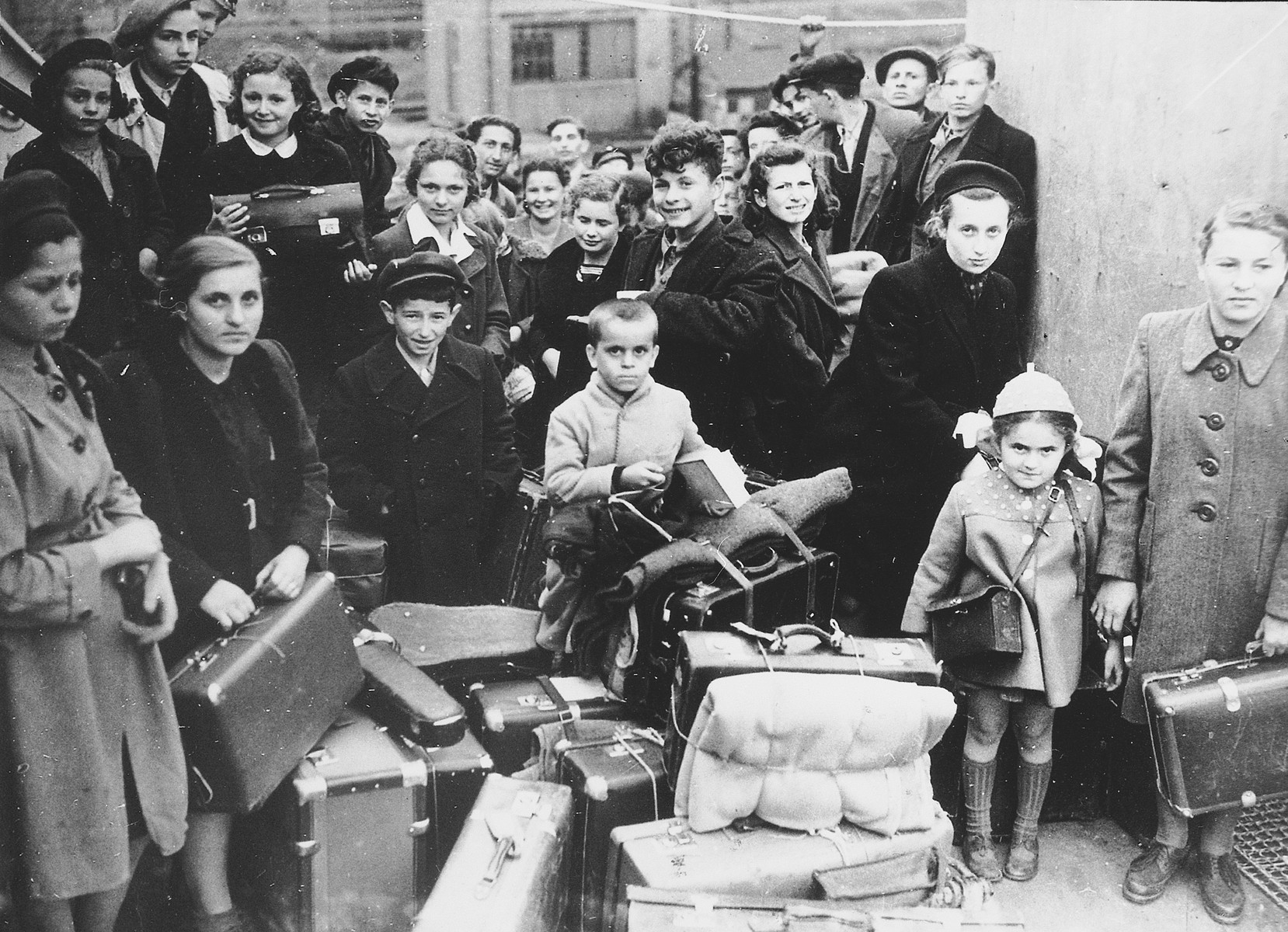 A group of child survivors arrives in Scotland by ship in a transport organized by Rabbi Solomon Schonfeld.  Approximately 200 children left on this transport organized with the support of the British Foreign Office.  Among those pictured are Elek Rebensztok (front center), Richard Vanger (directly behind Elek Rebensztok), Hannah Greenberg (top, third from left), and Jerzy Hoffman (top, fourth from left).
