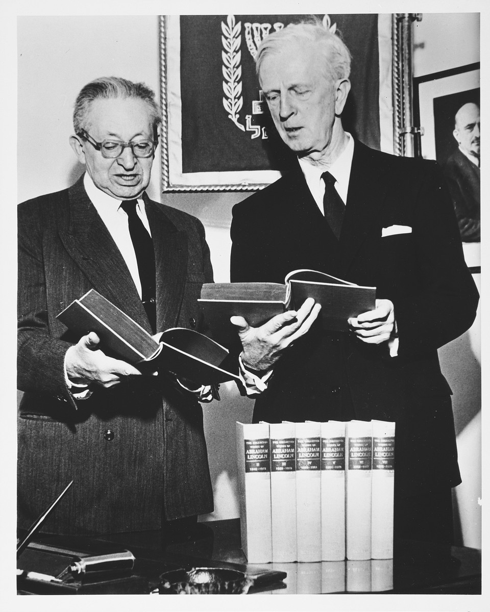 Ambassador James Grover McDonald and Israeli President Yitzhak Ben Zvi examine a collection of the works of Abraham Lincoln.