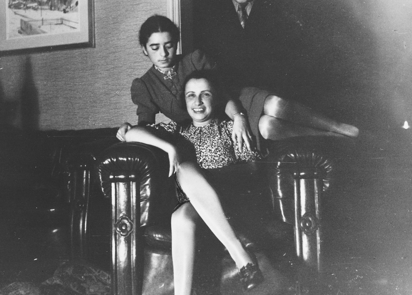 Two German-Jewish women pose together on a large leather armchair.  Pictured on the left is Margot Bähr.