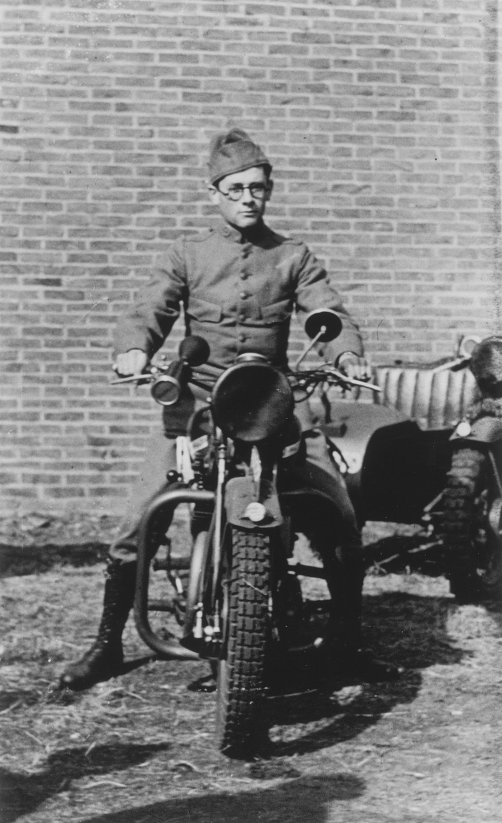 A Jewish soldier in the Dutch army poses astride his motorcycle.  Pictured is Leo Krell.