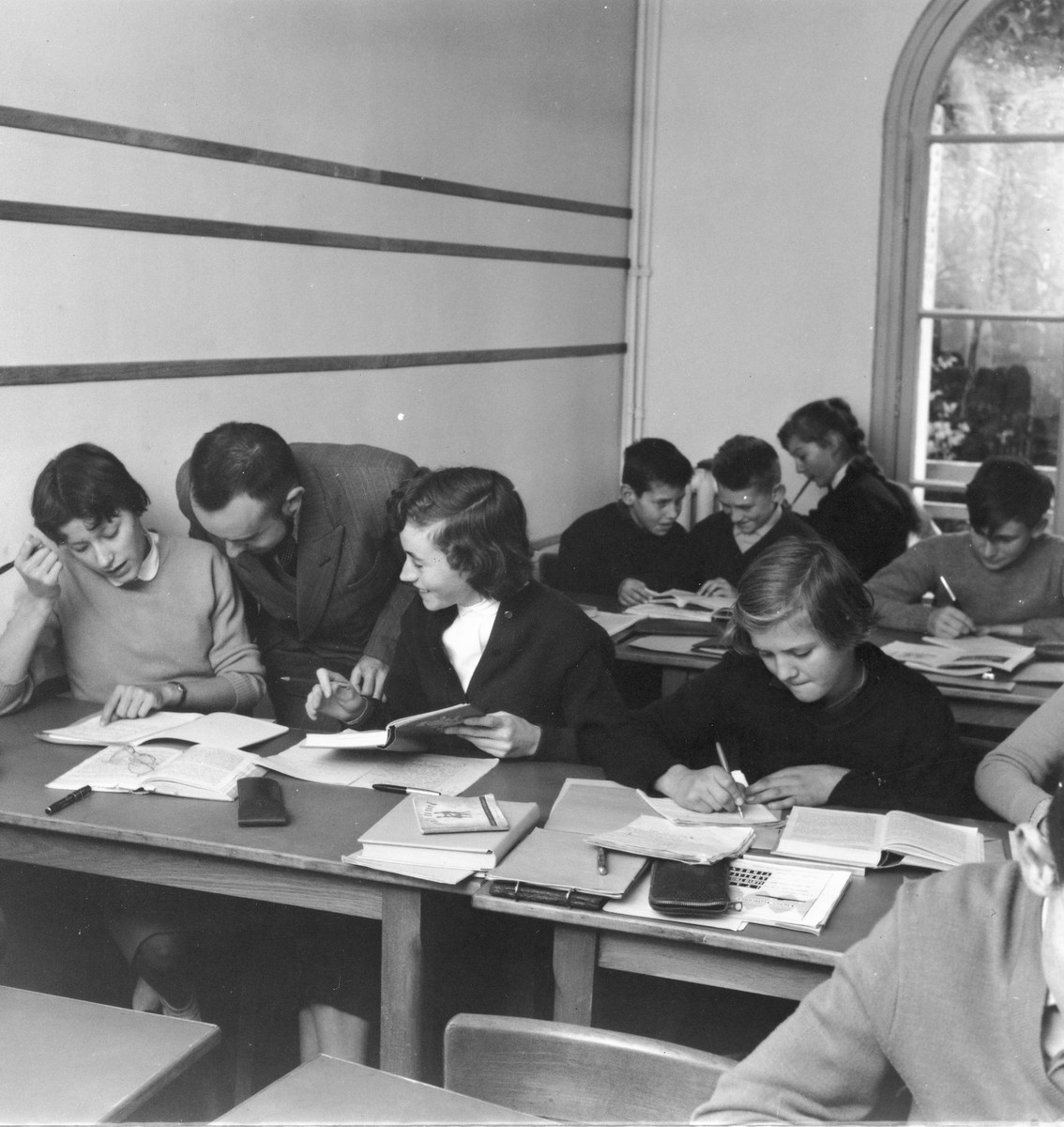 Children study at their desks in a classroom of a postwar OSE home, [possibly Fontenay-aux-Roses].
