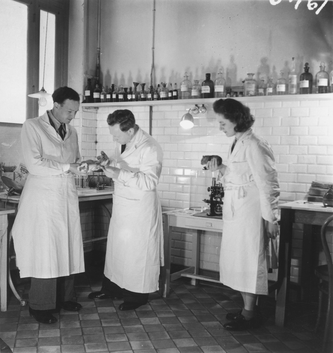 Three pharmacists work in their lab in the OSE clinic in Paris on rue Marcadet.