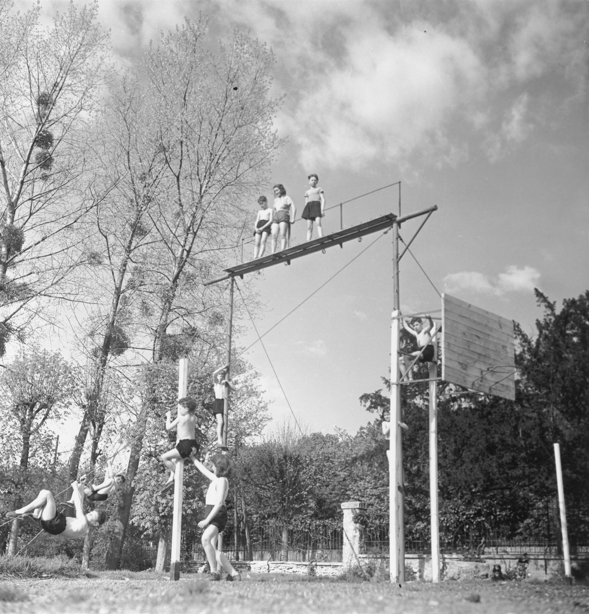 Children scale poles and platforms in Gournay-sur-Marne, an OSE kinesthetic institute for children with bone deformations.